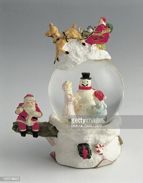 Collecting Snowglobes Christmas Theme Children with Snowman