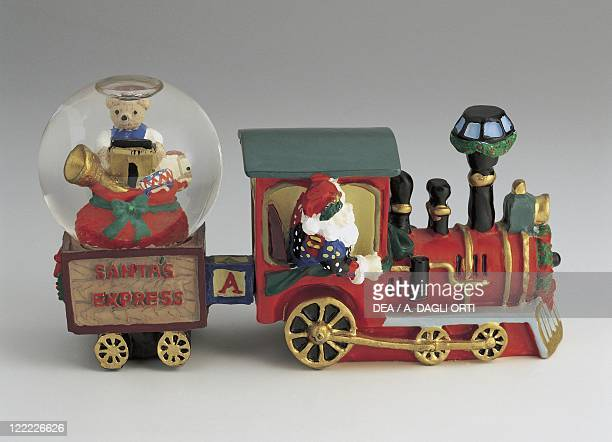 Collecting Snowglobes Christmas Theme Santa Claus in a Train Loaded with Gifts