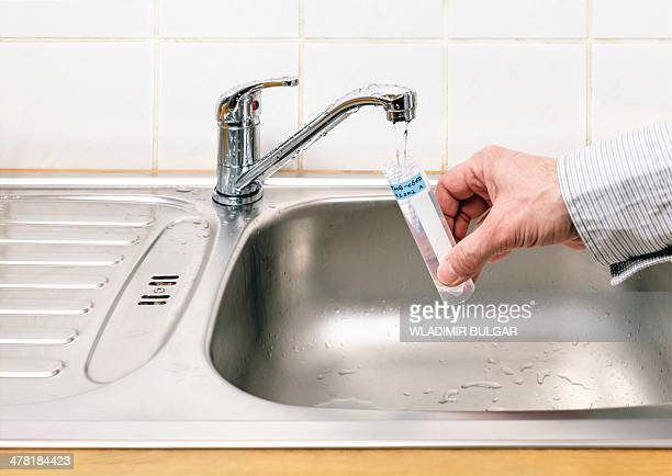 Collecting tap water sample