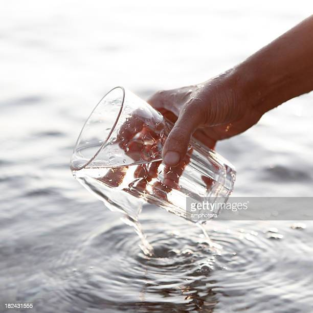 Collecting water in a clear glass