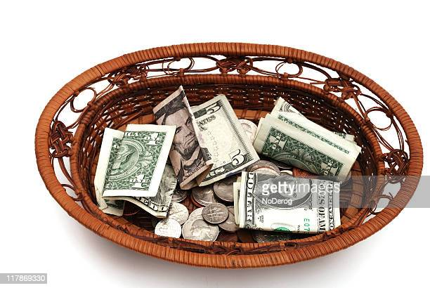 Collection basket filled with money