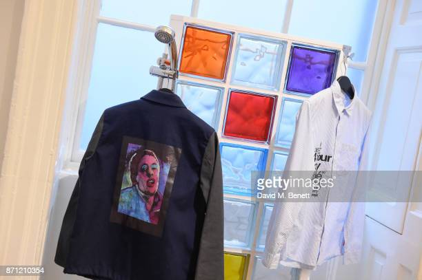 A collection by fashion designer Paul Smith featuring artwork by Jeremy Deller of Shaun Ryder on display during a press preview of 'North Fashioning...