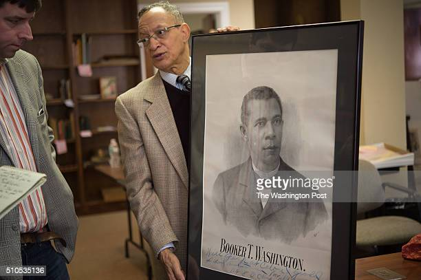 Collection expert Jacob B Johnson III holds a 1910 lithograph poster of a young Booker T Washington is part of the Howard Wolverton Collection of...