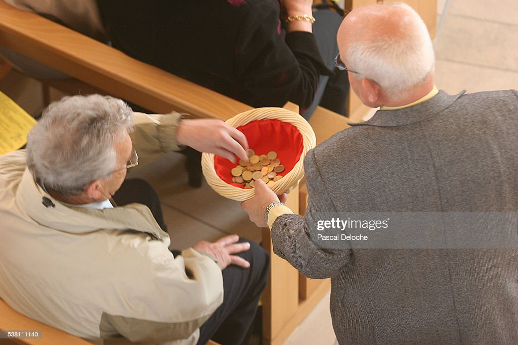 Collection in Mass at Annecy Church : Stock Photo