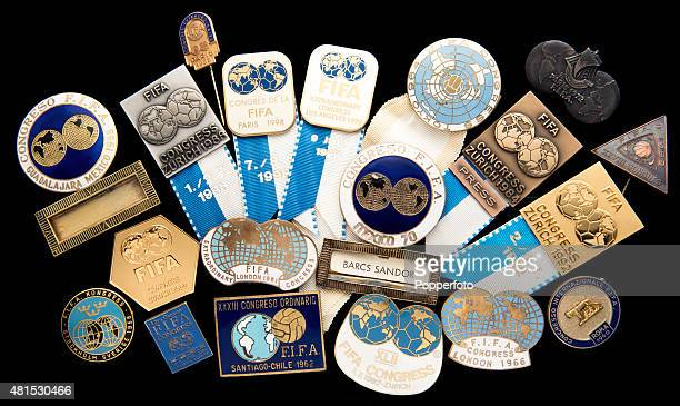 A collection of 19 FIFA Congress badges some marked 'Extraordinary' from 1952 to 2000