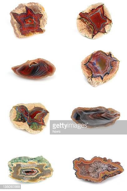 collection of agates with red inside on white background