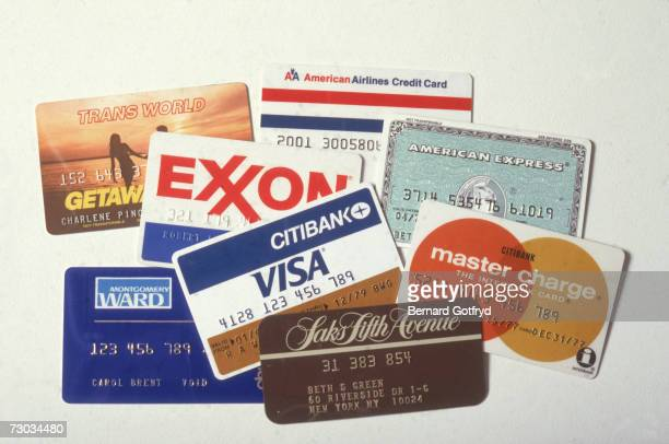 A collection of American credit cards late 1970s Pictured are cards from Trans World and American airlines Exxon Montgomery Ward and Saks Fifth...