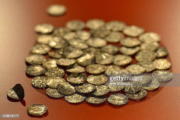 A collection of AngloSaxon coins from Tyskegard in Denmark dating back to 1000AD are pictured during a photocall for the 'Vikings Life and Legend'...