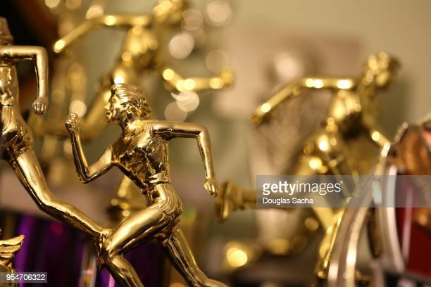 collection of awards and trophy's of athletic success - influencer award stock photos and pictures