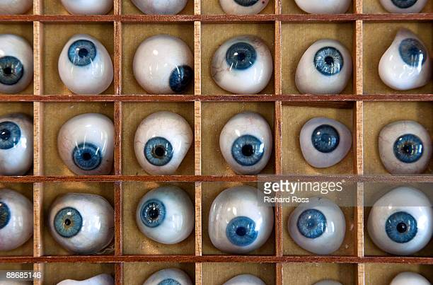 A collection of blue prosthetic eyes