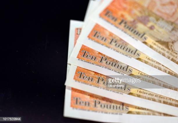 A collection of British 10pound banknotes sit in this arranged photograph in London UK on Wednesday Aug 15 2018 The pound's weakness is turning...