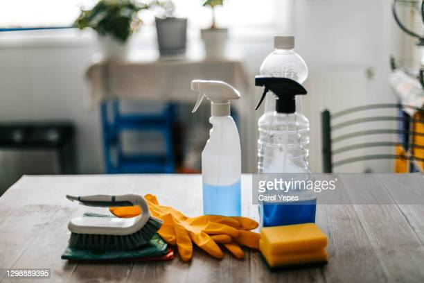 collection of cleaning supplies on surface of the kitchen table - cleaning agent stock pictures, royalty-free photos & images