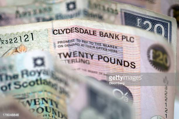 Collection of Clydesdale Bank Plc and Royal Bank of Scotland Group twenty pound bank banknotes are displayed in this arranged photograph at a...