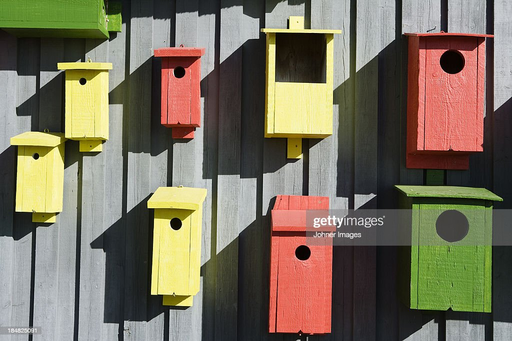 Collection of colorful birdhouses : Stock Photo