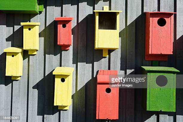 collection of colorful birdhouses - imbalance stock photos and pictures