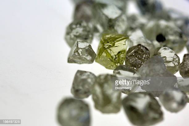 A collection of colorless and colored uncut diamonds sit on a sorting table during processing at DTC Botswana a unit of De Beers in Gaborone Botswana...
