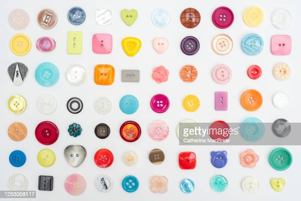 collection of colourful buttons - catherine macbride stock pictures, royalty-free photos & images