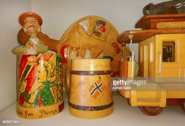 Collection of decorated handmade wood objects, mugs, cable car and souvenirs.