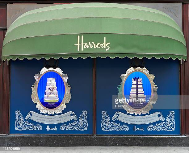 A collection of designer tiered wedding cakes on display at Harrods on April 26 2011 in London England Harrods commemorates the royal wedding with an...