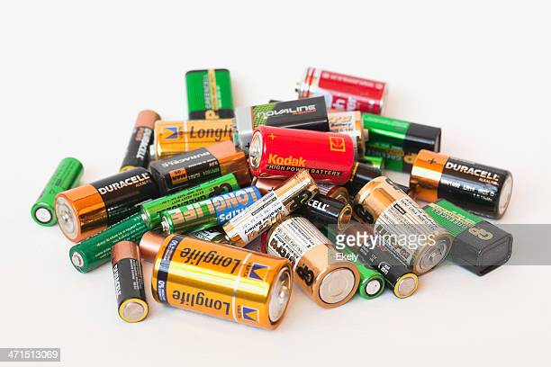 collection of different battery brands - alkaline stock pictures, royalty-free photos & images