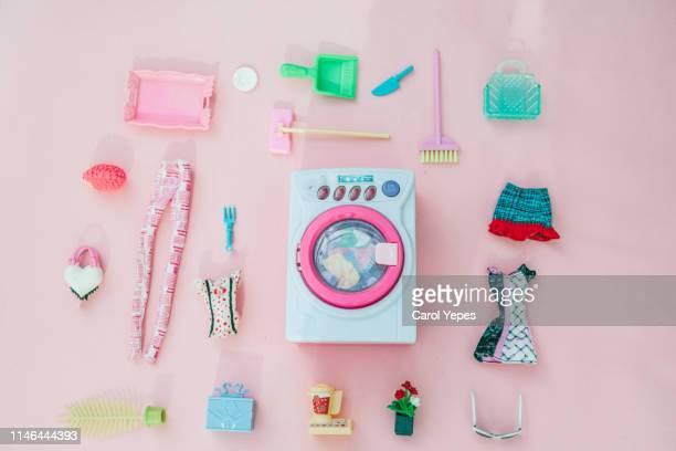 collection of dolls accesories in pink background.top view - symbool stockfoto's en -beelden
