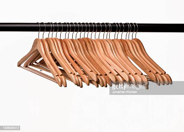 A collection of empty coat hangers on a rail