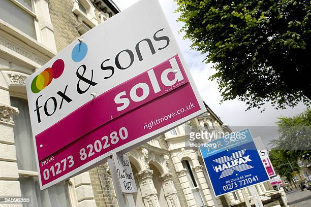 A collection of estate agents signs showing residential properties for sale and sold are lined up in Tisbury Road Hove West Sussex UK on Monday July...