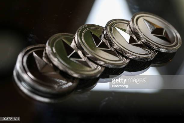 A collection of ethereum tokens sit in this arranged photograph in Danbury UK on Tuesday Oct 17 2017 On Wednesday billionaire Warren Buffett said on...