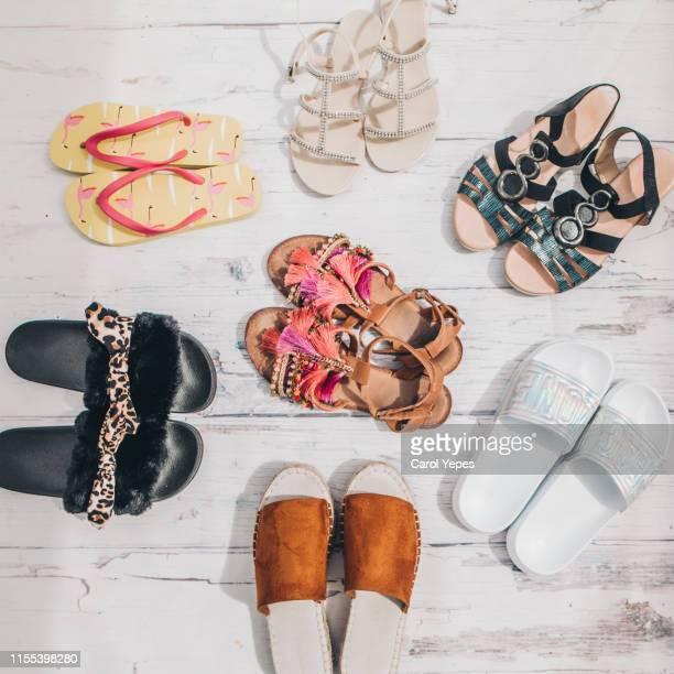 collection of female summer sandals top view - sandale stock-fotos und bilder
