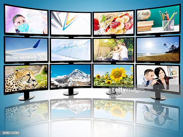collection of flat screen televisions broadcasting different cable channels - large group of objects stock pictures, royalty-free photos & images