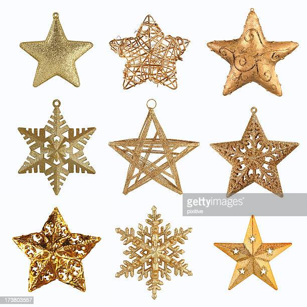 collection of gold christmas stars - christmas ornaments stock photos and pictures