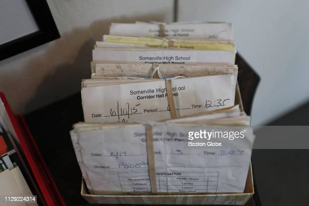 """Collection of hall passes from Somerville High School is displayed at the """"Our Stories, Our Stuff, Our Somerville"""" show at the Somerville Museum in..."""