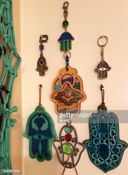 a collection of hamsahs, good luck charms - hamsa symbol stock photos and pictures