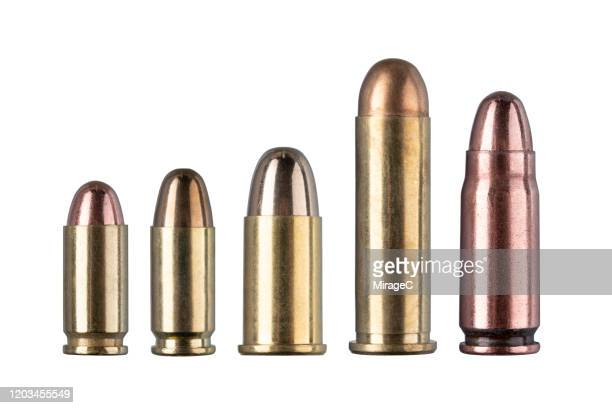 a collection of handgun bullets - bullet stock pictures, royalty-free photos & images