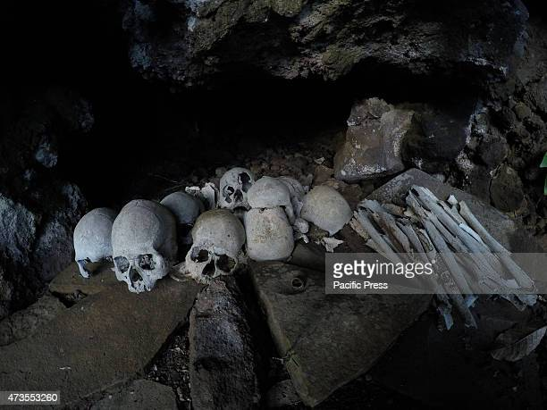 Collection of human skulls with bones, of unknown origin, was in a small cave on the island of Siau. The skulls had been there about a hundred years...