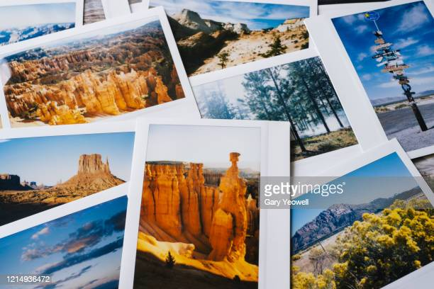 collection of instant travel holiday photos on a table - image focus technique stock pictures, royalty-free photos & images