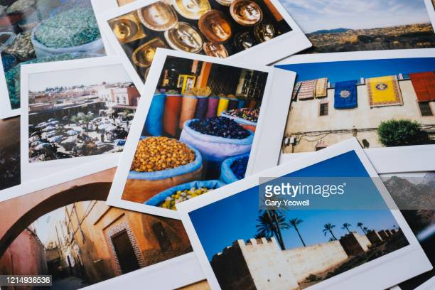 collection of instant travel holiday photos on a table - memories stock pictures, royalty-free photos & images