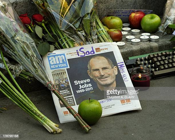 A collection of items outside the Apple Flagship store on 5th Avenue in New York October 6 2011 the morning after the death of former Apple CEO and...