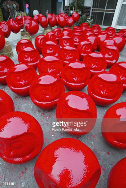 A collection of Japanese good luck charms called Daruma await painting ahead of the major national elections today November 9 2003 in Takasaki Japan...