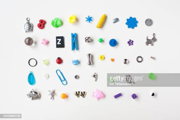 collection of little tiny objects knolling - hergestellter gegenstand stock-fotos und bilder
