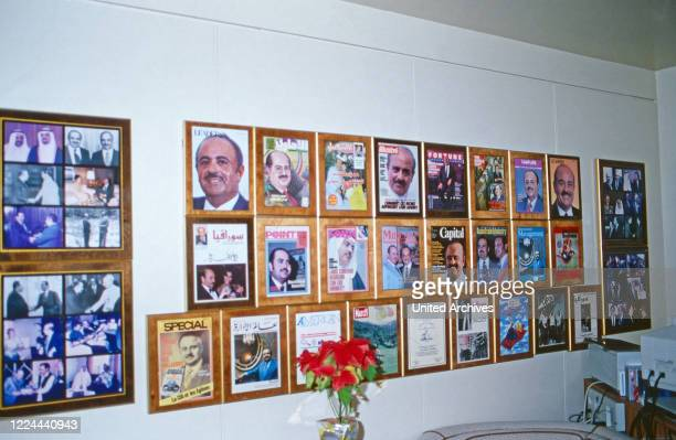 Collection of magazine covers with Adnan Khashoggi's portrait at his office at Olympic Tower in New York, USA 1986.