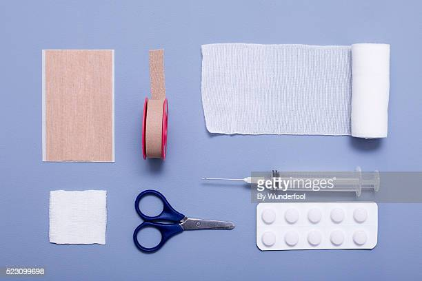 collection of medical objects put together on a blue background seen from above - elastic bandage stock photos and pictures