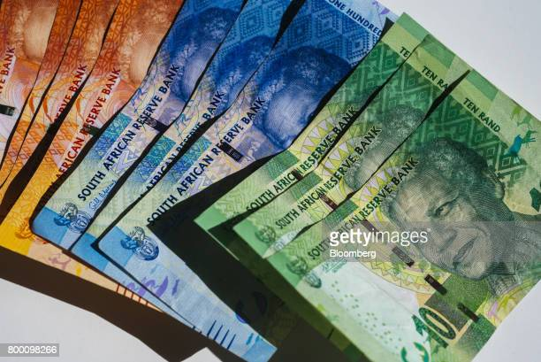A collection of mixed denomination South African rand banknotes sit in an arranged photo in Johannesburg South Africa on Thursday June 22 2017 South...
