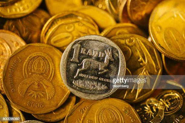 A collection of mixed denomination South African rand coins sit in an arranged photo in Johannesburg South Africa on Thursday June 22 2017 South...