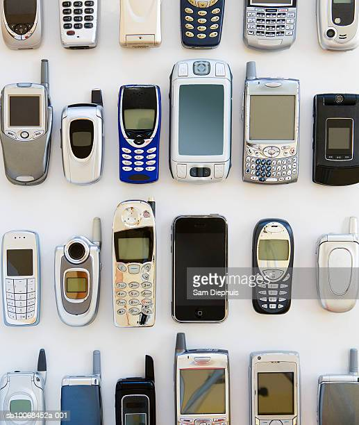 collection of mobile phones against white background - groupe moyen d'objets photos et images de collection