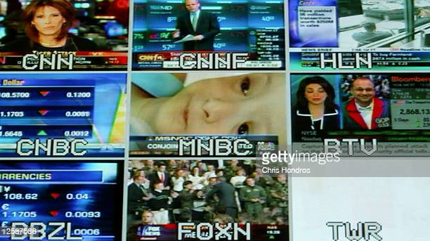 A collection of news and financial cable TV shows is shown on a split screen October 12 2003 at the Nasdaq headquarters in New York City