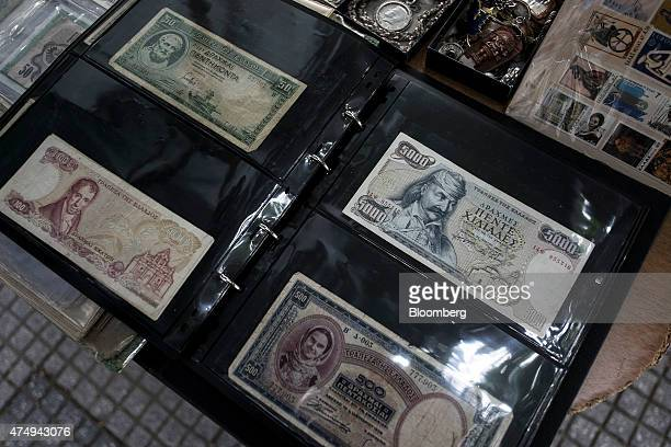 A collection of old Greek drachma banknotes sit for sale at an antique dealer's store in Thessaloniki Greece on Wednesday May 27 2015 Greek banks...