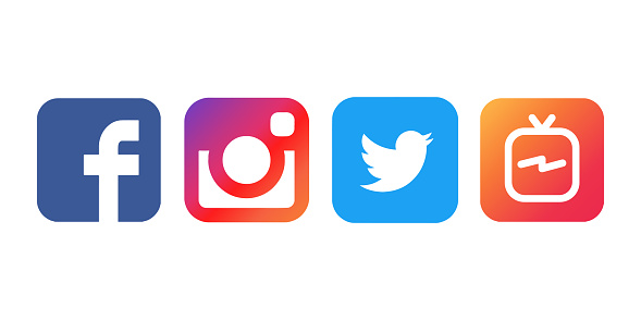 Collection of popular social media logos printed on white paper: Facebook, Instagram, Twitter and IGTV. 1028361154