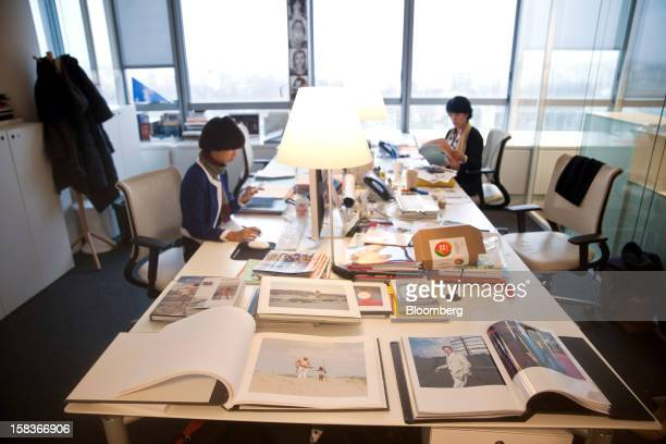 A collection of portfolio books is seen displayed on a desk inside the Havas SA headquarters in Paris France on Friday Dec 14 2012 Havas SA the...