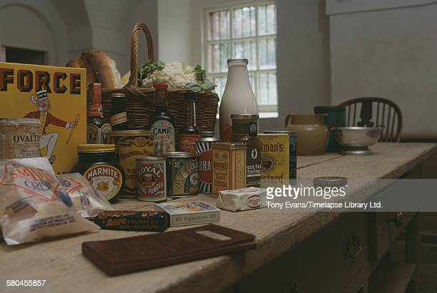 A collection of postwar food products from the 1950s including Ovaltine Marmite Lyle's Golden Syrup Brasso Rowntree's cocoa Colman's mustard Smith's...